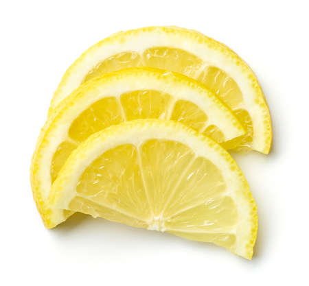 Heap of lemon half slices isolated on white background, top view