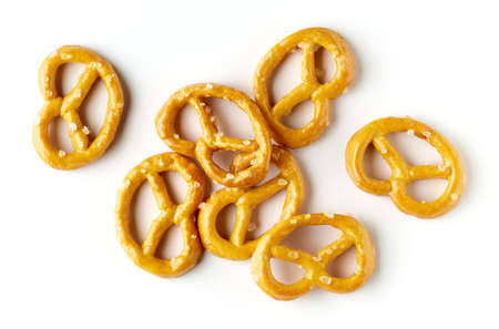 Heap of salted mini pretzels isolated on white background, top view Stock Photo