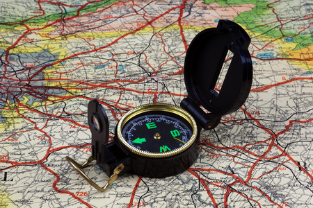 country roads: Compass sitting on old road map of Scotland. Stock Photo