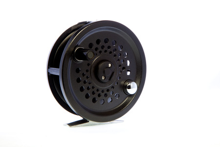 passtime: Traditional fly fishing reel against a white background.