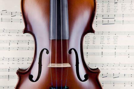 rosin: Classical violin on open old manuscript book.