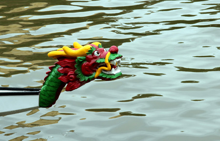 south east asian: The carved prow of a traditional South East Asian dragon boat on the Sarawak river, Kuching, Borneo.