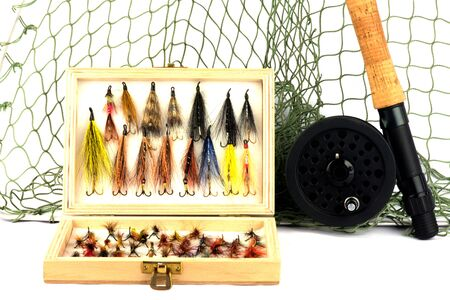liesure: Fly Fishing Equipment with Flies in Wooden Fly Box on White Background