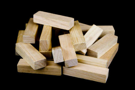 play blocks: Pile of wooden play blocks isolated on black background Stock Photo