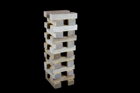 play blocks: Stack of wooden play blocks isolated against a black background Stock Photo
