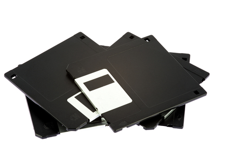 obsolete: Obsolete computer floppy discs isolated on a white background