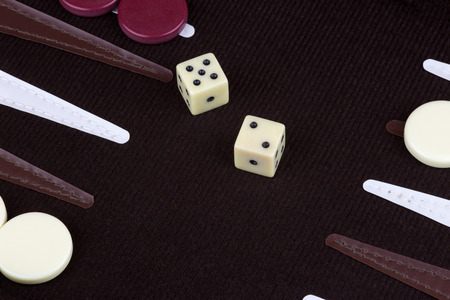 gambling counter: A game of Backgammon in mid play Stock Photo