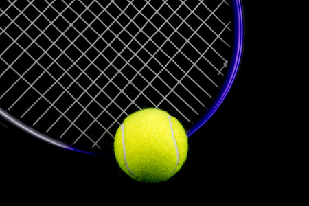 tennis racquet: Tennis racquet and tennis ball isolated against a black background