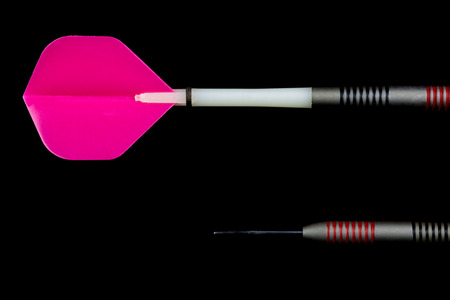 Dart flight and point sections isolated against a black background
