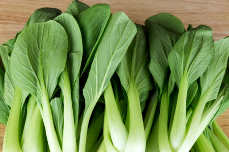 bok choy: Fresh Asian Bok Choy Leaves on a Wooden Table