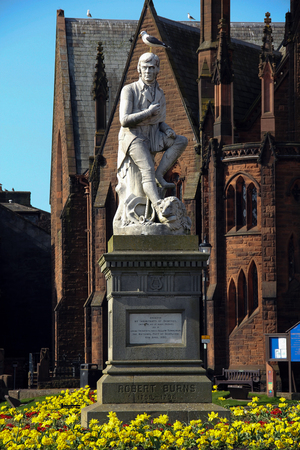 national poet: Statue of poet Robert Burns with seagull in Dumfries Scotland