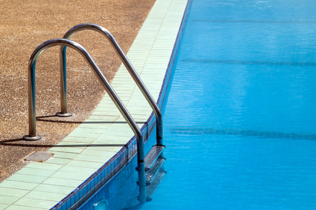 chromium plated: Outdoor swimming pool with handrail and access ladder