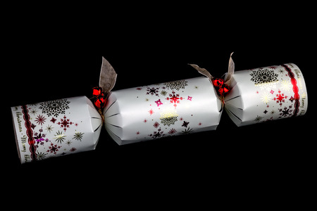 christmas cracker: Traditional Christmas cracker isolated against a black background