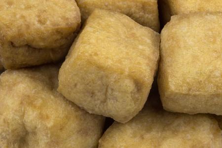 soya bean: Fried soya bean curd or tofu cubes close up