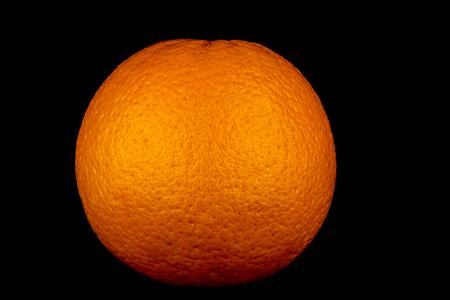 Large orange isolated against a black background Stock Photo
