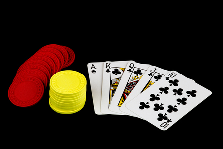 dealt: A winning poker hand with chips on black background
