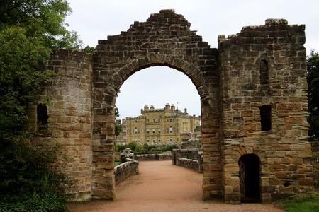 View of Culzean Castle through stone archway