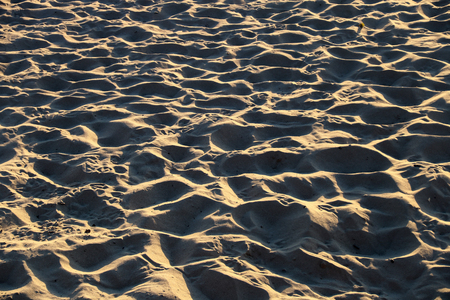 Rippled sand at a sunlit coastal beach Banco de Imagens
