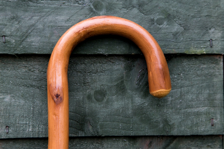 Walking stick handle against an old garden shed