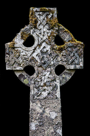 Ancient celtic cross in a Scottish cemetery