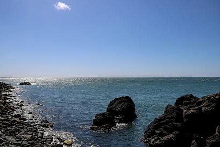 Rocky coastline in southern Scotland on a sunny day