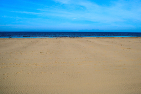 Seascape and deserted beach at a coastal location Stock Photo