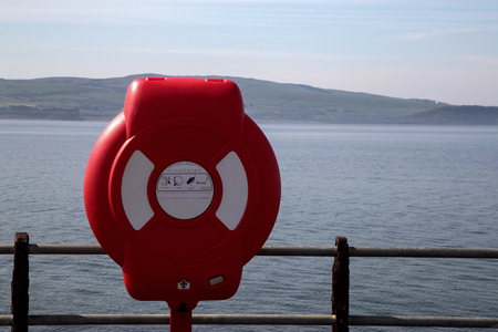 Life preserver situated at a coastal harbour location