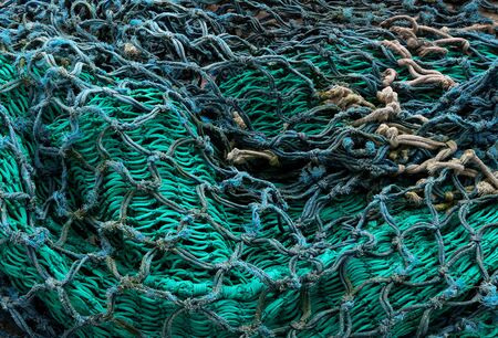 Old fishing nets at a coastal harbour close up view
