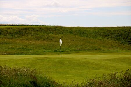 Green and flag stick at a golf course