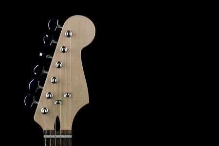 Electric guitar peg head and tuning keys isolated on black 写真素材