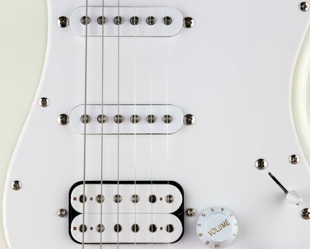 Partial electric guitar body and pick ups close up view 写真素材
