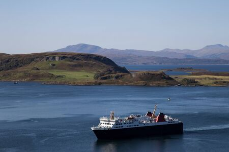 Passenger ferry sailing into Oban harbour Scotland