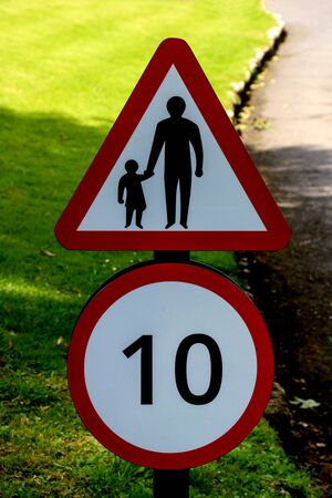 Speed and children walking warning sign on a rural road Stock fotó