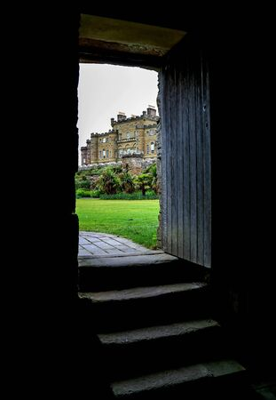 Culzean castle Scotland viewed through an ancient doorway
