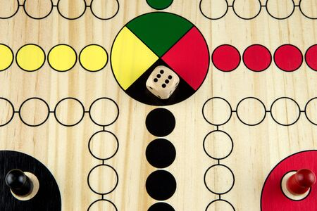 Wooden painted ludo game board section close up
