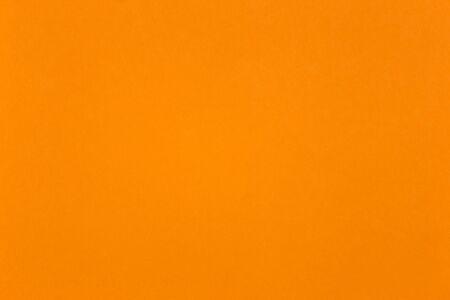 Orange coloured parchment sheet close up for use as background Banque d'images