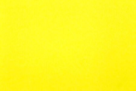 Yellow coloured parchment sheet close Up for use as background