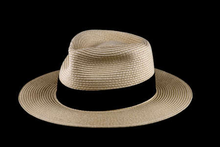 Straw Panama hat isolated against a black background