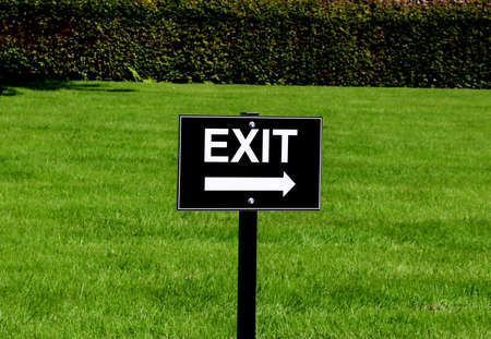 Black and white exit sign at a country attraction car park Stock fotó