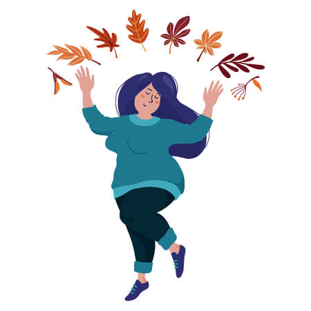 Pretty chubby woman dancing under falling leaves