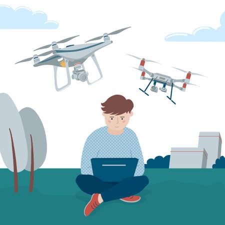 Boy operating quadcopter drones via his laptops