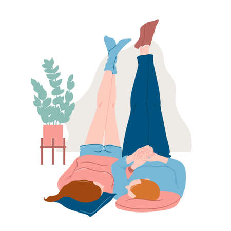 Cute romantic couple lying on the floor in home clothes with legs up, holding hands, looking at each other, relaxing together, flat vector illustration isolated on white background