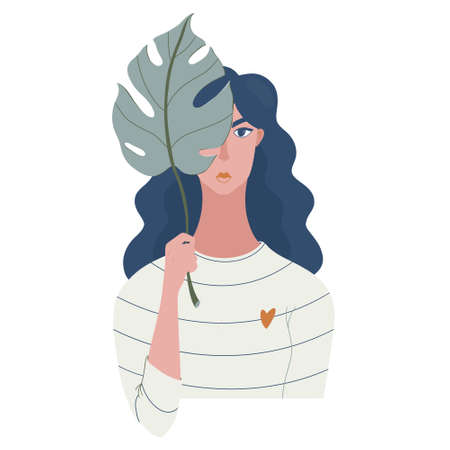 Pretty girl, woman hiding face with monstera leaf