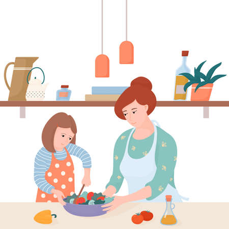 Mom and daughter cooking together, making salad
