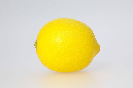vividly: Vividly colored whole lemon fruit on white background