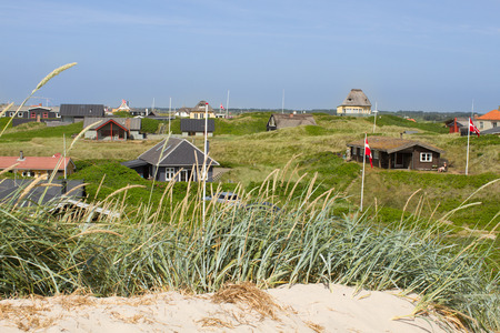 jutland: Panoramic view of summer houses at the North Sea shores of Western Jutland, Denmark  Sun is shining and the sky is bright blue  Editorial