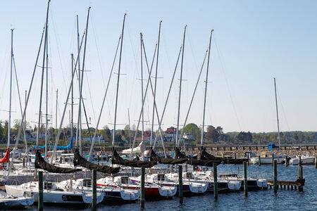 northern european: A line-up of sailing boots in northern european Marina