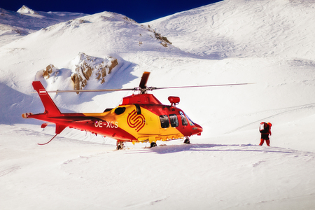 heli: Rescue helicopter ready to provide assistance in snowcovered mountain settings.