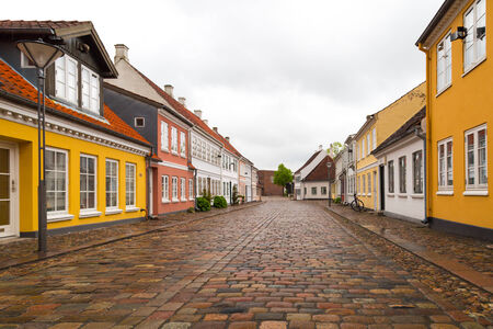 Low angle view of old street in the city centre of Odense, Denmark.
