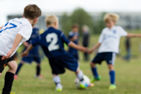 Blurred youth soccer players during a an outdoors soccer match. photo